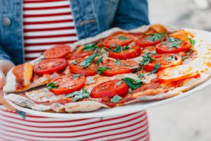 crop-anonymous-woman-with-plate-of-yummy-pizza-4193872